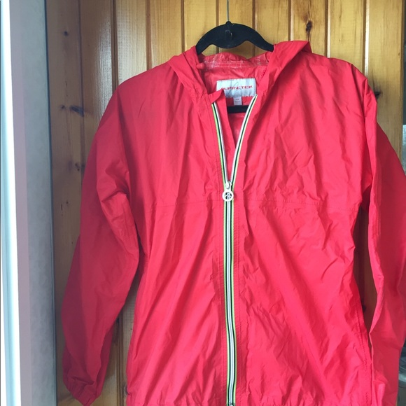 Alpinetek softshell packable rain jacket.